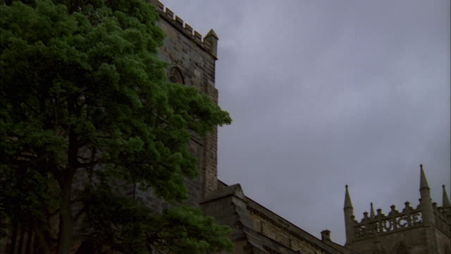 stormy clouds fill the sky above dunfermline abbey in fife, scotland. available in hd. - dunfermline stock videos & royalty-free footage