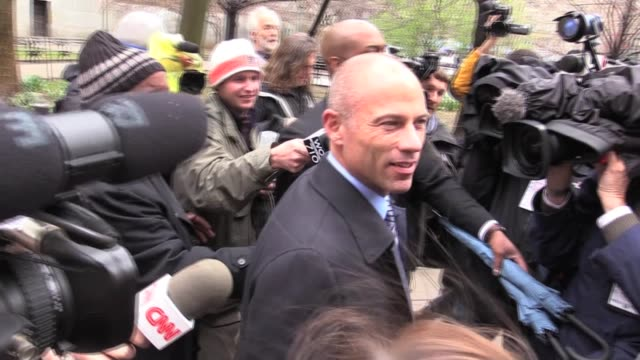 stormy daniels' attorney michael avenatti walks down street as reporters ask questions - journalist video stock e b–roll