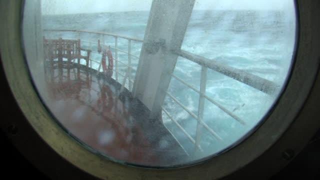 CU, Stormy ocean seen through porthole, South Georgia Island, Falkland Islands, British overseas territory