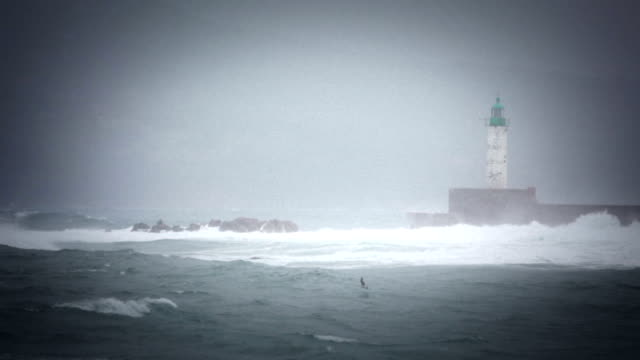 Stormy rough sea and lighthouse