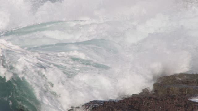 stormy sea crashes onto rocky shore, cornwall, uk - atlantic ocean stock videos & royalty-free footage