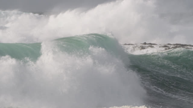 stormy sea crashes onto rocky shore, cornwall, uk - atlantic ocean stock videos & royalty-free footage
