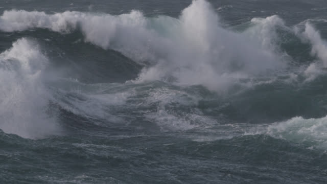 stormy sea crashes onto shore, cornwall, uk - broken stock videos & royalty-free footage