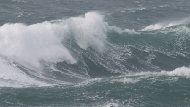 stormy sea crashes onto shore, cornwall, uk - atlantic ocean stock videos & royalty-free footage