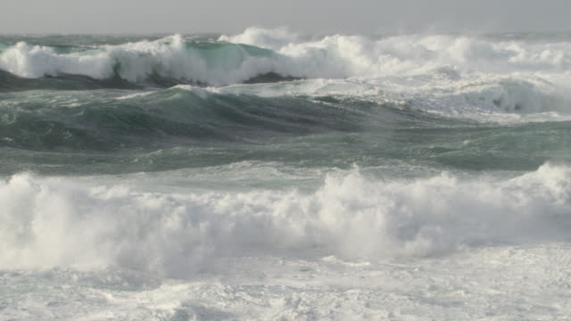 stormy sea crashes onto shore, cornwall, uk - majestic stock videos & royalty-free footage