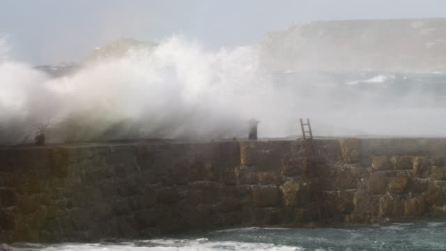 stormy sea crashes over harbour wall, cornwall, uk - ladder stock videos & royalty-free footage