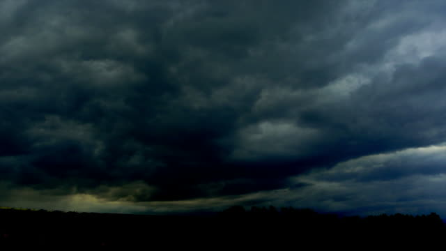 t/l stormy sky over solar power plant - stimmungsvoller himmel stock videos & royalty-free footage