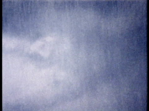 1975 MS Stormy sky with torrential rainfall / United States / AUDIO