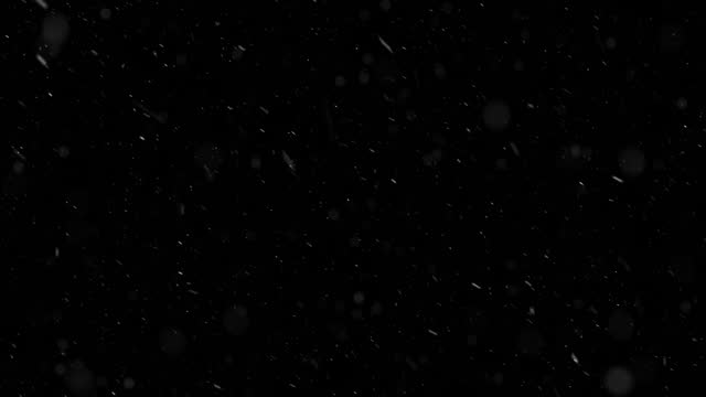 stormy snow fall on black background - snowing stock videos & royalty-free footage