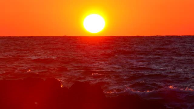 Stormy sunset on a rocky coast