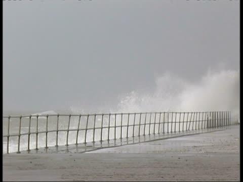 MWA Stormy waves crashing in to sea wall, Spray splashing over wall