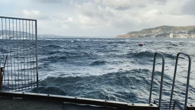 stormy weather at bergen harbor, with strong winds and rough sea - meteorology stock videos & royalty-free footage