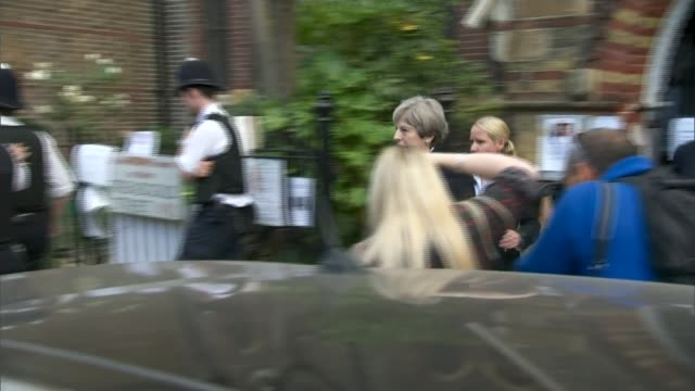 stormzy backed grenfell petition passes 100000 signatures lib / 1662017 ext theresa may mp leaving church after visiting grenfell tower relatives and... - stormzy stock videos and b-roll footage