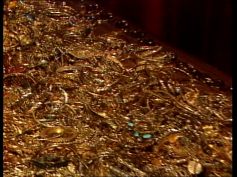 story 2 cms woman donor pull out as stand by table full of gold / cms gold jewellery on table pan rl / cms notes counted by machine / ms wads of... - iraq stock videos & royalty-free footage
