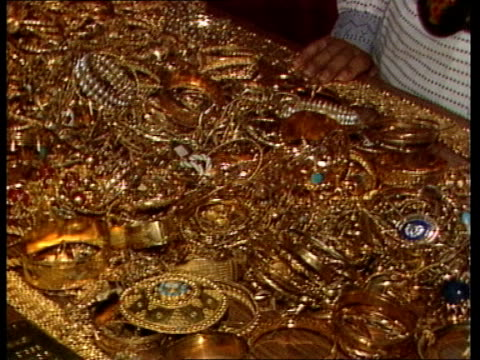 story 2 ms woman donor pull out as articles on table checked /cms gold jewellery from donations / cms currency notes being counted / ms wads of... - iraq stock videos & royalty-free footage