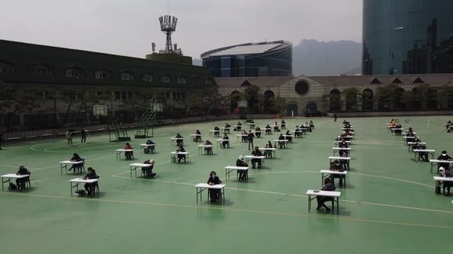 south korean students sit for public exam amid the coronavirus pandemic south koreans wear masks and sit according to social distancing as a... - concetti video stock e b–roll