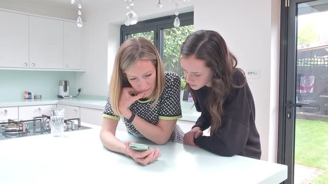 Story of 13yearold Holocaust victim told through Instagram ENGLAND Kent INT Mia Quiney setup looking at mobile phone with reporter and interview SOT