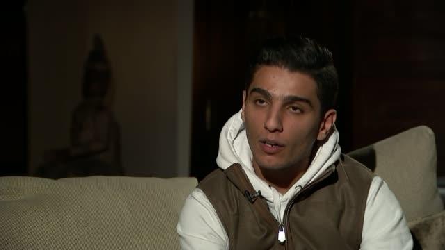 story of arab idol winner mohammed assaf made into film england london various shots mohammed assaf chatting to reporter mohammed assaf interview sot... - 伝記映画点の映像素材/bロール