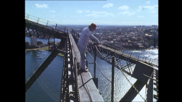 story on the sydney harbour bridge maintenance painting and workers jenny harvey reports part 2 view looking down on harbour bridge traffic seen... - bennelong point stock videos and b-roll footage