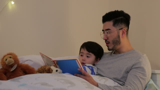 storytime in bed - candid stock videos & royalty-free footage
