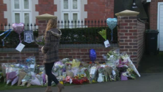 lydia wilkinson lays flowers at family home stourbridge stabbings lydia wilkinson lays flowers at family home england west midlands stourbridge ext... - west midlands stock videos and b-roll footage