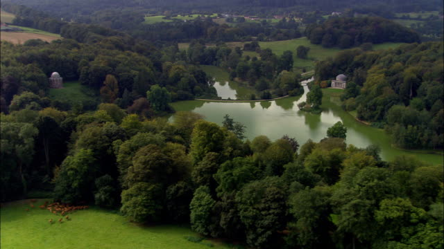 stockvideo's en b-roll-footage met stourhead landschapstuin - luchtfoto - engeland, wiltshire, stourton met gasper, verenigd koninkrijk - wiltshire