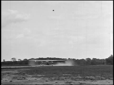 stockvideo's en b-roll-footage met b/w 1927 stout air lines airliner taking off over camera / newsreel - 1927