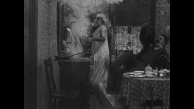 1915 stove explodes while maid and wife argue and husband jumps up in shock - edwardian style stock videos & royalty-free footage