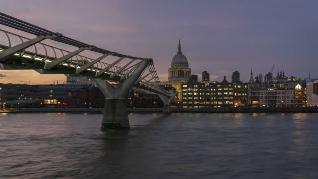 st.paul's cathedral and millennium bridge in london, 4k time-lapse from dusk to night - london millennium footbridge stock videos & royalty-free footage