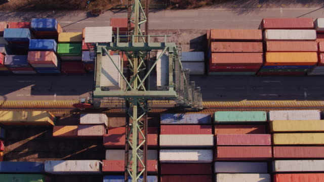 Straddle Carrier in Shipping Container Yard - Aerial Shot