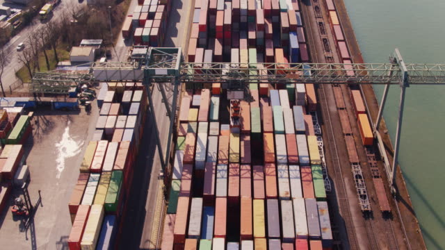 Straddle Carrier Unloading Shipping Containers from Train - Drone Shot