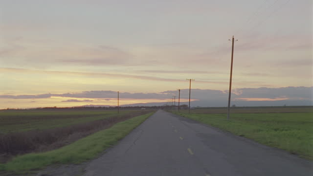 d/x straight back 2-lane rural blacktop highway; no traffic, magic hour - moving process plate stock videos & royalty-free footage