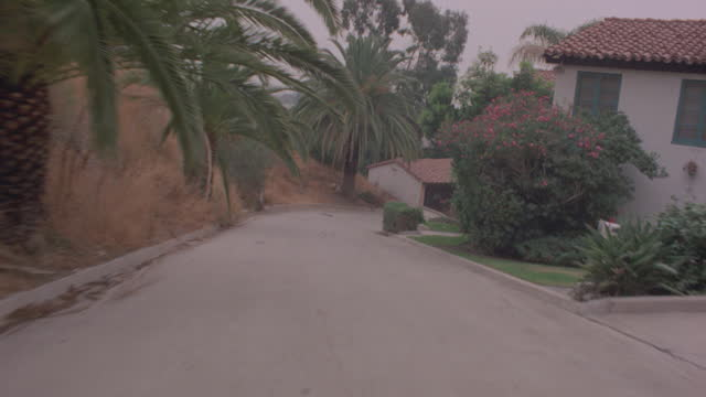 straight back form a stop car travels up sweetzer, crosses sunset blvd., past attractive homes and into driveway where it stops; uphill all the way - southern california stock videos & royalty-free footage