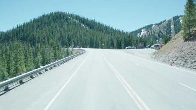 vidéos et rushes de straight back process 2 - lane paved mountain road - driving plate image animée