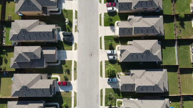 straight down in the middle of two sides of the neighborhood - home ownership stock videos & royalty-free footage