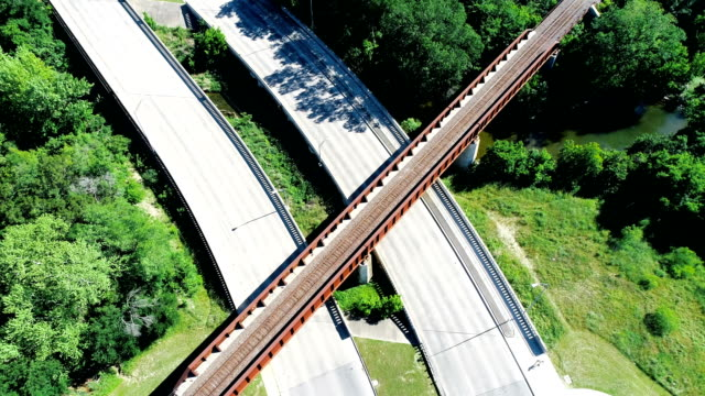 straight down view above bridge and highways transportation in round rock , texas - neighborhood street sign stock videos and b-roll footage