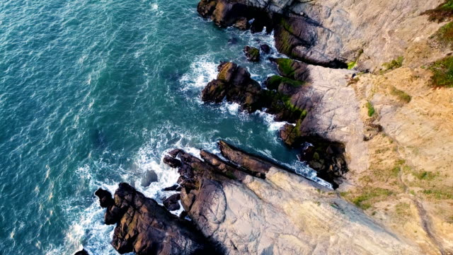 straight down view of rocky empty baker's beach next to golden gate bridge in san francisco , california - san francisco bay stock videos & royalty-free footage
