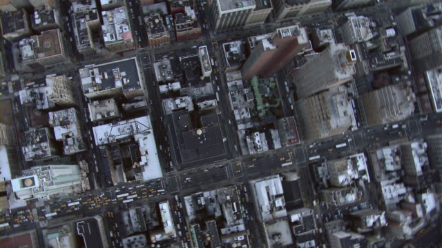 straight down view over city streets of midtown manhattan. - block shape stock videos & royalty-free footage