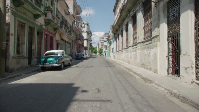 straight forward process havana, cuba city streets - personal land vehicle stock videos & royalty-free footage