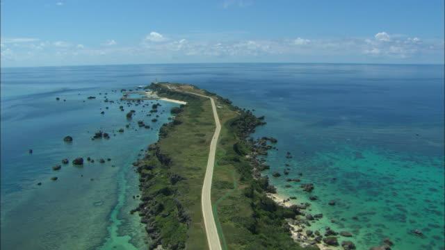 WS POV AERIAL Straight road at island /  Okinawa, Japan