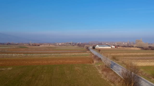 Straight road in rural area - aerial view