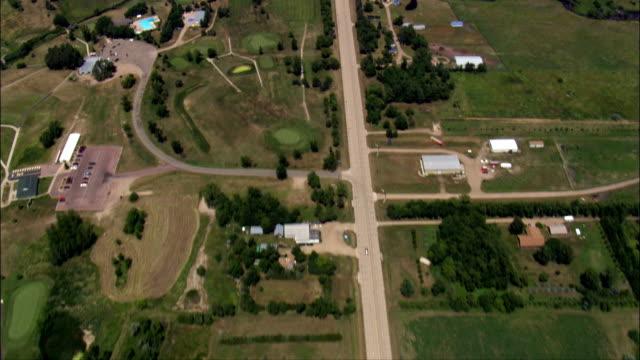 straight road near huron - aerial view - south dakota, beadle county, united states - south dakota stock videos & royalty-free footage