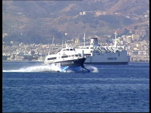straits of messina to be joined by bridge itn boats along tgv straits of messina pan - stretto video stock e b–roll