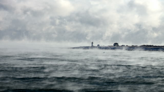 straitsmouth island light in arctic sea smoke - rockport massachusetts stock videos & royalty-free footage