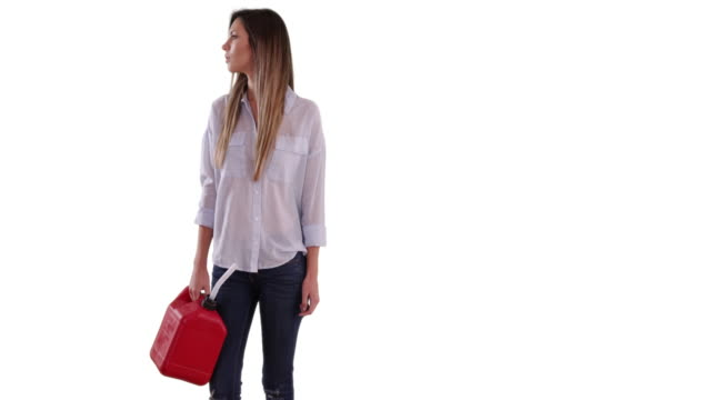 stranded female motorist with red gas can looking for help on white background - bombola video stock e b–roll