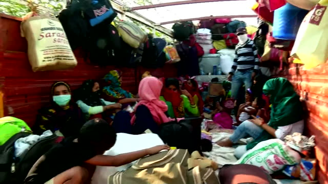 stranded migrant women and children travel on truck to reach home from aligarh uttar pradesh on may 16 india - uttar pradesh stock videos & royalty-free footage