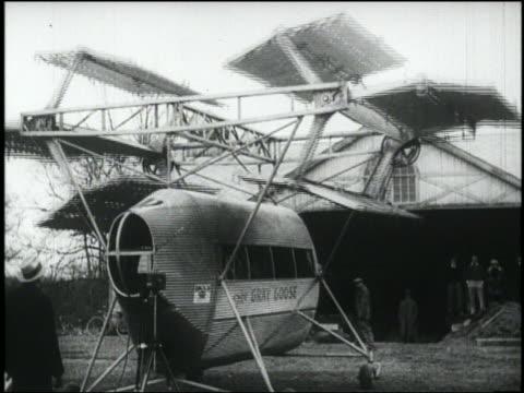 B/W strange flying machine with rotating blades