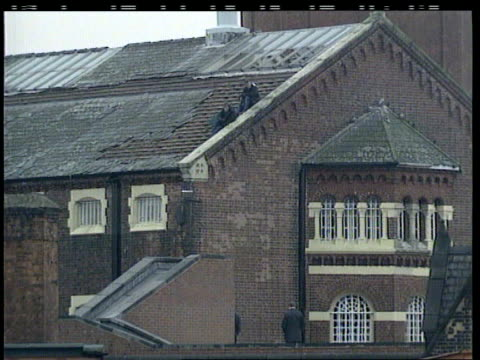 day 10 england manchester strangeways prison night prison riot officers seen walking along injured officers lifted on stretchers into ambulances day... - hm prison manchester stock videos & royalty-free footage