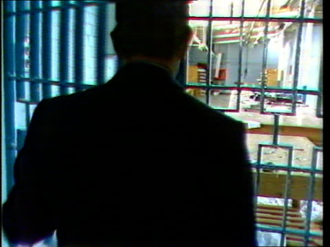 strangeways prison riot: background; 9:48 bulletin: england: isle of wight:albany jail cbv prison officer opens door and into damaged workshop av... - hm prison manchester stock videos & royalty-free footage