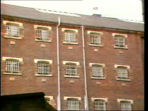 background 948 bulletin england manchester strangeways prison gv windows zoom in int ms prisoners talking on landing cms prison officer opening cell... - prison cell door stock videos & royalty-free footage